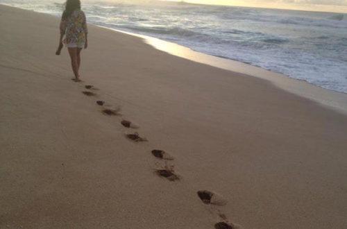 Woman walking down beach
