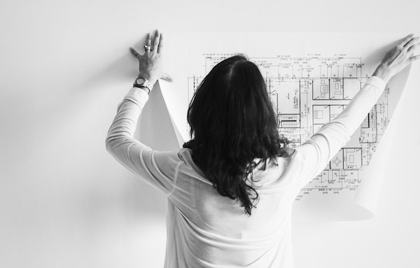 Woman holding up floor plan